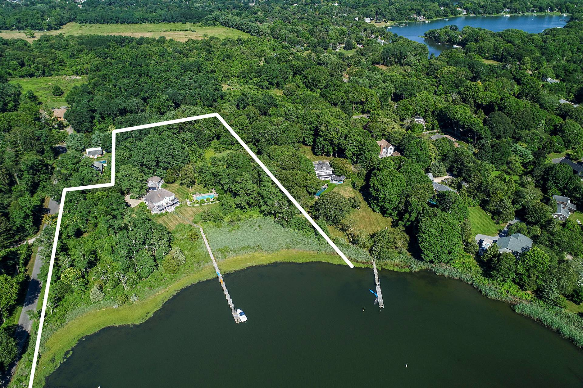 Single Family Home for Sale at Shelter Island Waterfront Oasis With Dock And Pool 9 North Menantic Road, Shelter Island, New York